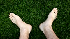 Happy feet on the grass, barefoot Stock Footage