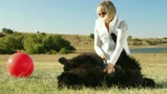 Young Woman Having Fun With Their Dogs Outdoor Stock Footage