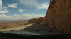 Precarious switch back dirt road coming of high desert into Mexican Hat - 3 Stock Footage