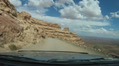 Precarious switch back dirt road coming of high desert into Mexican Hat - 2 Stock Footage