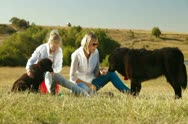 Mother and Daughter Feeding their Newfoundland Dogs Stock Footage