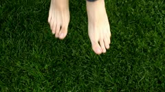 Feet jumping on the grass, barefoot - stock footage