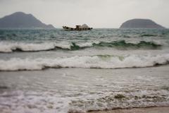 Fishing boats on the coastline and beautiful beach of Vietnam. Stock Photos