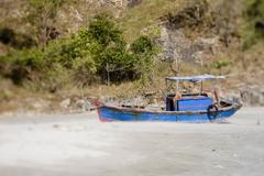 Fishing boat on the coastline and beautiful beach of Vietnam. Stock Photos