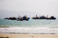 fisher boat on the coastline and beautiful beach of Vietnam. - stock photo