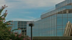 Airliner Flies over Office Building Stock Footage