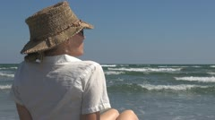 Woman watching the sea lady lifestyle seascape ocean admire island tropical gulf Stock Footage