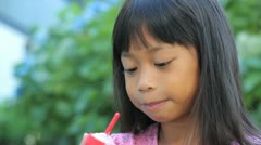 Smiling Asian Girl Enjoys A Popsicle-Close Up Stock Footage