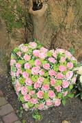 heart shaped sympathy arrangement - stock photo