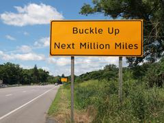Buckle up sign and highway Stock Photos