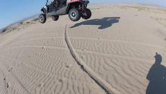 OHV jump in the sand dunes HD5516 Stock Footage