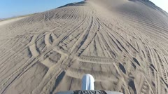 Dirt bike riding the face of Sand Mountain POV HD5559 Stock Footage