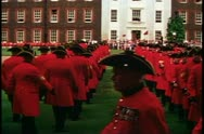 Stock Video Footage of Royal Chelsea pensioners, marching on parade, long shot, Chelsea, England