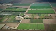 Stock Video Footage of Beautiful Farmland flyby aerial shot of huge farms in the Midwest