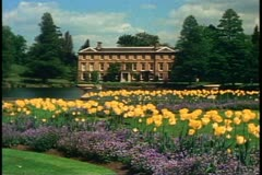 Kew Gardens, England, garden foreground, small palace in background Stock Footage