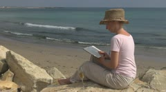 Young woman read drink white wine beach leisure celebration relax glamour ocean Stock Footage