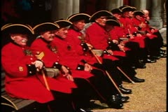 Royal Chelsea pensioners, old men in red uniforms, Chelsea, England Stock Footage