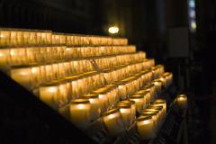 church candles in notre dame de paris - stock photo