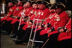Royal Chelsea pensioners, disabled men seated with walkers, Chelsea, England Stock Footage