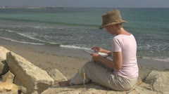 Beautiful woman read drink white wine on the beach champagne celebration glamour Stock Footage