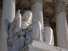 supreme court statue - stock photo
