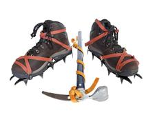 vintage crampons and ice axe. - stock photo