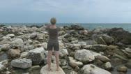 Beautiful woman doing exercises on the beach coastline sport lifestyle health  Stock Footage