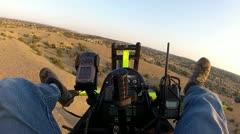 Ultralight pilot fly low over desert HD 039 Stock Footage