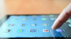 Sliding program icons on a touchscreen of Apple iPad New device Stock Footage