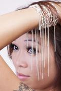 Tight portrait attractive young asian american woman Stock Photos