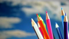 Colored pencils, rotation in the background the sky. Stock Footage