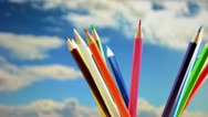Stock Video Footage of Colored pencils, rotation in the background the sky.