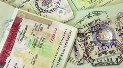 International passports with visas (USA, Egypt, Thailand and Shengen visas) Stock Footage