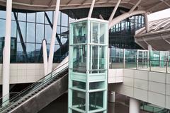 Stock Photo of glass elevator and escalator