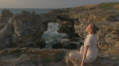 Woman doing yoga beach, coastline ocean sunset sunrise fitness armony nature sea Stock Footage