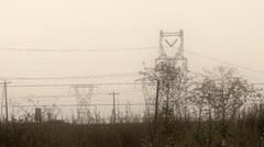 Power lines, highway, trucks Stock Footage