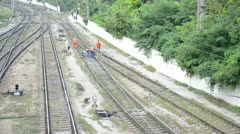 Workers of railway measure the parameters of track Stock Footage