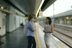 Businesspeople standing on the train station with coffee cup Stock Footage