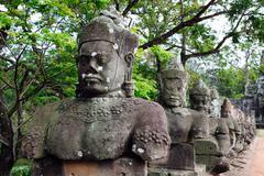 statues near ankor thom gate - stock photo