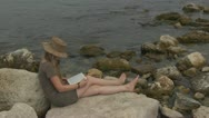 Beautiful girl reading on the beach book learn agenda consultation lifestyle  Stock Footage