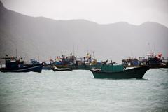 Fishing boats and coastline and beautiful beach of Vietnam. Stock Photos