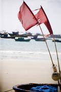 fisher boats on the coastline and beautiful beach of Vietnam. - stock photo