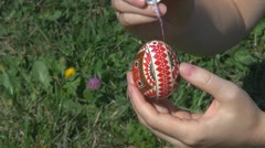 Lady painting Easter egg tradition design paint pencil hand fingers Stock Footage