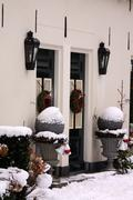Two frontdoors with christmas wreath decoration Stock Photos