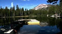 boats docked on a small dock with calm water lake Mammoth Ca. nature beauty - stock footage