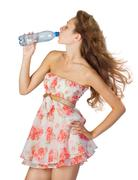young girl with bottle of water. - stock photo