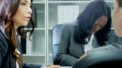 Close up of multi ethnic business team planning funds in office  - stock footage