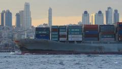 Container ship sails past the city skyline - stock footage