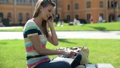 Female student with cellphone and laptop on campus, steadicam shot HD Stock Footage