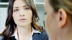 Close up of Caucasian businesswoman managing female colleagues in boardroom   - stock footage